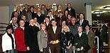 Foto: Uni-Rektor Prof. Dr. Nikolaus Risch (1. Reihe 4. v. re.), daneben links MdL Maria Westerhorstmann und Günter Krogmeier, Amtsgerichtsdirektor Delbrück. Mitte rechts Organisator Christoph Schön