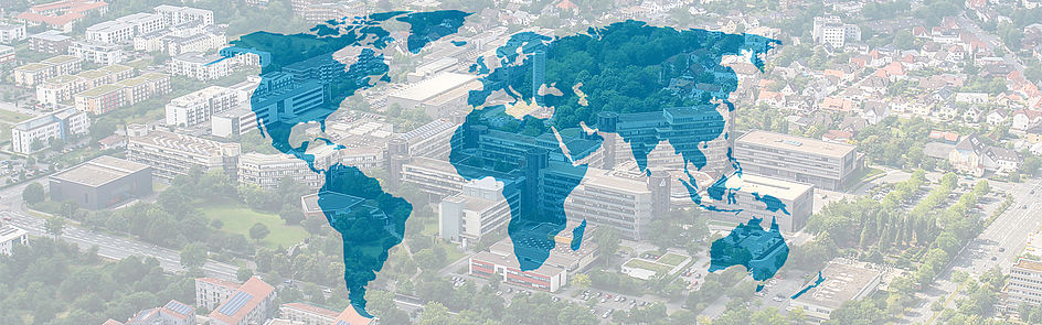 World map with aerial view of Paderborn University