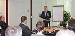 Foto (Universität Paderborn, Jana Neuhaus): Dr. Michael Laska referiert bei einem Tag der IT-Sicherheit.