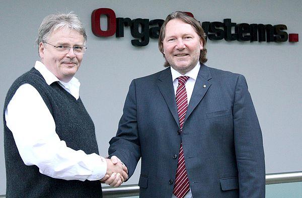 Foto (v. li.): Rainer Neumann, CEO, Orga Systems GmbH, und Prof. Dr. Michael Dellnitz, Vorstandsvorsitzender des Instituts für Industriemathematik, Universität Paderborn